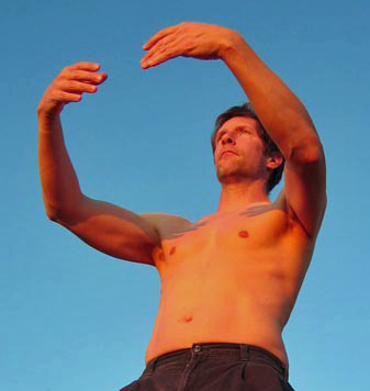 That's me doing standing meditation. I don't usually do it shirtless, but my partner Stephanie and I were at Big Sur at sunset in January, and it was an unusually warm 70 degrees. I'm facing the setting sun.