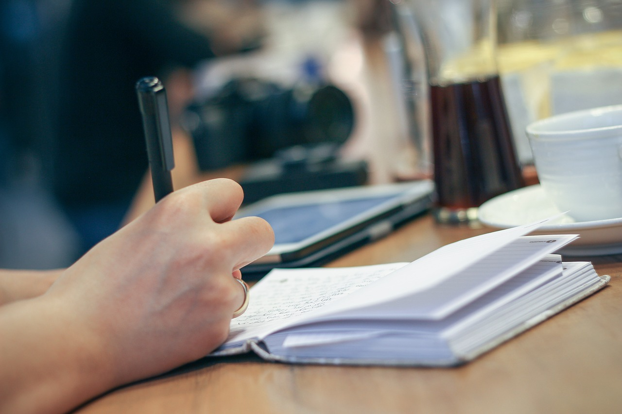 Freelance writers interview people and take notes for their magazine articles and blog posts.